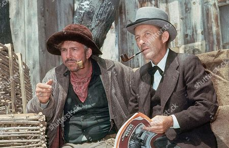 "Bing Crosby, Slim Pickens Bing Crosby with actor Silm Pickens on location for film ""Stage Coach"" in August 1965"