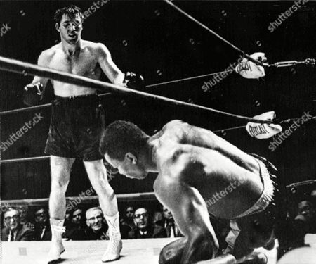 American boxer Thad Spencer falls to the canvas after being hit by American boxer Jerry Quarry in the 10th round of their 12-round semi-final heavyweight elimination match in Oakland, Calif., on . It was the second time Spencer was knocked down. The fight was stopped in the 12th round and the match was awarded to Quarry