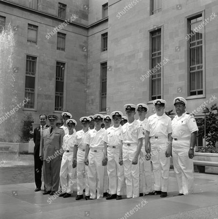 Sea Scouts from the Rochester, N.Y., area who are being awarded quartermasters certificates pose in the courtyard at the Rayburn Building in Washington on . With them, at left, are Rep. Barber Conable, Jr., R-N.Y., and Admiral E.J. Roland, Coast Guard commandant. The scouts, from left, front: Roger Taylor, John Wallace, Dan Carter, Duane Stewart, Mike Aaron, and Commander John Traber. Rear: Terry White, William Martz, Faulkner White, Dennis Lemley, Peter Harris, and Richard Beach