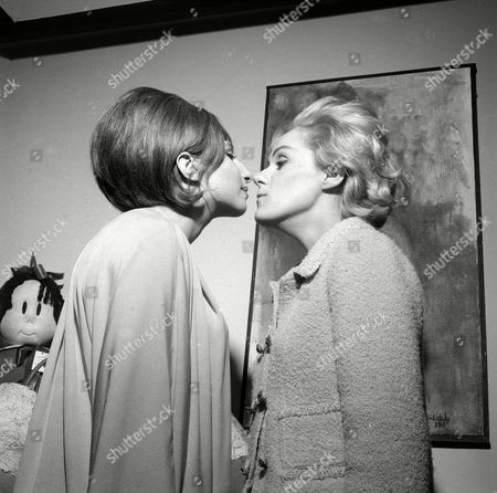 """Watchf Associated Press Domestic News Entertainment New York United States APHS12781 BROADWAY """"FUNNY GIRL"""" 1964 Two of Broadway's brightest young commediennes, Barbra Streisand, left, and Tammy Grimes, ham it up in Miss Streisand star marked dressing room at a benefit performance of """"Funny Girl"""" in New York, . Miss Grimes is appearing in """"High Spirits."""" The benefit was for the Actorys Equity Fund"""