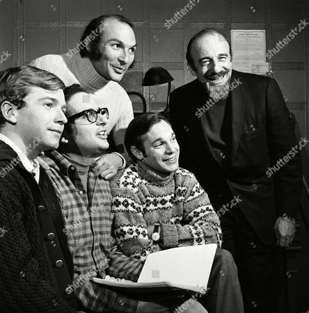 """Trying out Broadway theater production for the first time is Mitch Miller, the """"sing-along"""" man, shown . At the Billy Rose Theater in New York City, where the show """"Here's Where I Belong"""" opens February 20, Miller, right, stands with his working crew, Terence McNally, left, writer; Alfred Uhry, center, lyrics; and Robert Waldman, right, music; and, standing behind is the show's director, Michael Kahn"""