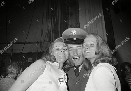 Stock Photo of Ralph Hitchcock, Sylvia Hitchcock, Margareta Arvidsson A/1C Ralph Hitchcock gets a royal welcome after a tour in Vietnam from his sister Sylvia Hitchcock, Miss USA, left, and Margareta Arvidsson, Miss Universe of 1966, at Miami Beach, Fla., . Airman Hitchcock will be pulling for his sister in the current Miss Universe Beauty Pageant