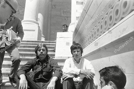 Thomas Mabany, left, of Pittsford, N.Y., and Brian McDonnell of Philadelphia sit on the steps of the Capitol in Washington on . They are fasting in protest against use of U.S. troops in Cambodia. Man in background, behind sign, is Tim Myers, who is not participating in the fast