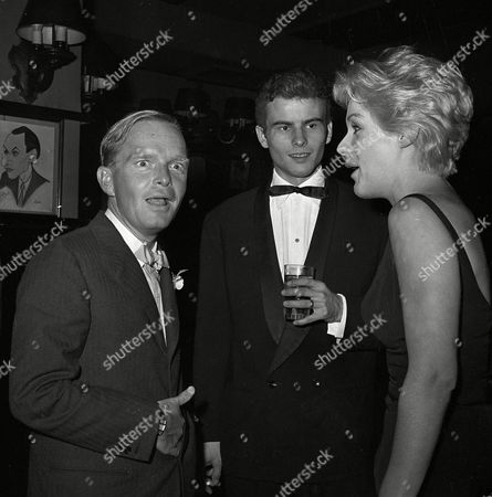 Capote Buchholz Grimes Writer Truman Capote, German actor Horst Buchholz, and actress Tammy Grimes are seen at Sardi's in New York