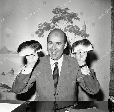 Televisions Carl Reiner, the comedian-actor-writer-director-producer, displays the new hairpiece he wears for acting roles, and then shows his thinking mans head, as it really is, Los Angeles, Calif. Reiner makes no secret of being bald, and wears his hair only when acting, or at night, like a piece of formal clothing