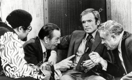 """Willie """"The Actor"""" Sutton, second from left, the noted bank robber recently released from prison, carries on animated discussion with George McGrath, right, commissioner of the New York City Department of Corrections, . The unlikely pair appeared on the Dick Cavett show. Man at left is ex-football player turned singer Rosey Grier"""