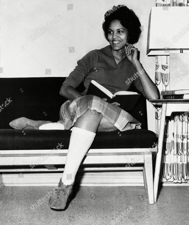 Student Charlayne Hunter, 18, the first Black girl to enter the University of Georgia, relaxes momentarily from her studies in her dormitory in Athens, Georgia, on