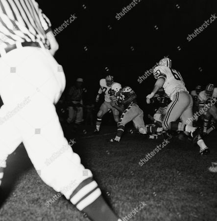 Don Anderson (44), Green Bay Packers' halfback, skirts right end for good gain in third quarter of the College All-Star game, Chicago, Ill. Blocking for Anderson are Marv Fleming (81), and Ken Bowman (57). Identifiable All-Stars are Bill Staley (74), Utah State, Mike McGill (60), Notre Dame, and Fred Carr (86), Texas-El Paso. Packers won, 34-17