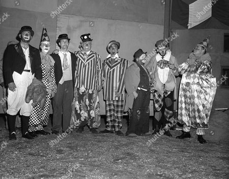 """Seven of these eight costumed clowns are radio and television personalities, while the eighth (third from right) is Otto Griebling, who earns his livelihood as a clown with Ringling Brothers and Barnum and Bailey Circus. Group gathered at New York's Madison Square Garden, for opening performance of """"The Greatest Show On Earth."""" From left are: Al Schacht, perennial baseball clown; Garry Moore, Sid Caesar, Lauritz Melchior, Jack Carter, Otto Griebling, Herb Shriner and Sam Levenson. The radio and TV personalities participated in the opening night performance with proceeds going to United Cerebral Palsy of New York"""