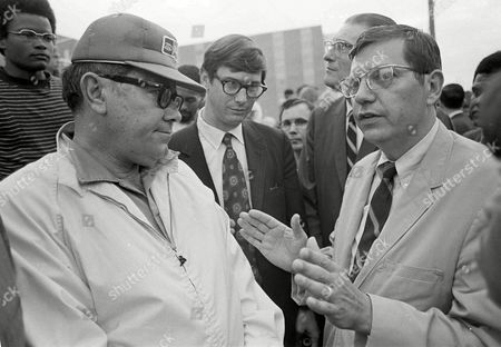 Deputy U.S. Attorney General Jerris Leonard, right, talks with Cecil Yarbro, a building commission official, about the removal of evidence from the scene at Jackson State College in Jackson, Miss., . Two African-American students were killed and 12 injured when police opened fire on a women's dormitory, claiming they were fired upon by snipers, shortly after midnight on May 15. At center is Justice Department attorney Frank Allen