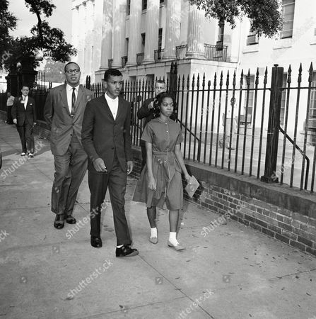 High school students Dorothy Bridget Davis, 16, and Henry Hobdy, 17, were registered by the Mobile County School Board, in Alabama. They are shown leaving board building after being registered without incident. Walking in rear is their attorney Vernon Z. Crawford