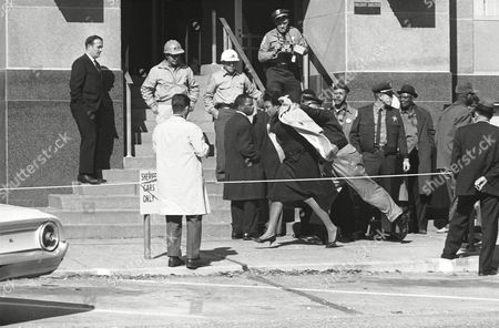 Racism; violence; pushing; shoving Amelia Boynton of Selma, is shoved along by her collar by Dallas County Sheriff Jim Clark following an argument which erupted as blacks lined up in front of the courthouse seeking to register to vote in Montgomery, Alabama
