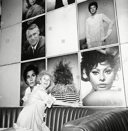 Phyllis Diller (front view) stands in front of her photo on in Hollywood, flanked by Jean Simmons, left, and Sophia Loren. Above are Cary Grant and Rosalind Russell