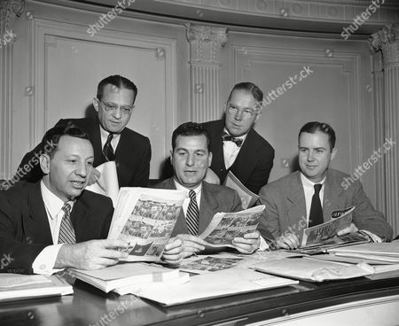 Stock Picture of Harold I. Panken, Joseph F. Carlino, James A. Fitzpatrick, Thomas A. Collins Members of a joint legislative committee to study the publication of comic books look over some of the books under discussion at hearing in New York's Bar Association Building on . Seated, left to right, are: State Senator Harold I. Panken of New York City; Assemblyman Joseph F. Carlino of Long Beach, N.Y., Committee chairman; and Assemblyman James A. Fitzpatrick of Plattsburg, N.Y. Standing, left to right; are: Reuben Lazarus of New York City, committee counsel, and Thomas A. Collins of Cold Spring, N.Y., legislative council to the committee