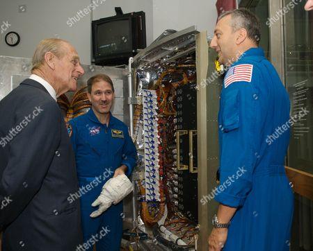 Prince Philip, speaks with veteran space walkers John M. Grinsfeld (centre) and Michael J. Massimino at NASA's Goddard Space Flight Center