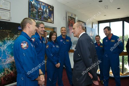 Prince Philip greets astronauts from STS-125 (left to right) Andrew J Feustel, Michael T Goode, K. Megan McArthur, Michael J. Massimino, Gregory C. Johnson, and Commander Scott D. Altma