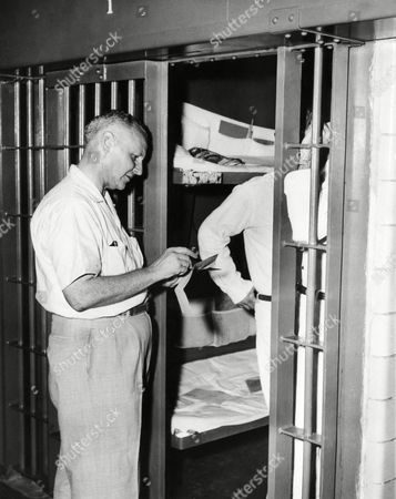 Don Reid Don Reid Jr., who has watched 129 men die in the electric chair, interviews two inmates of the Texas state penitentiary's modern death house in Huntsville on . Reid, editor of a semi-weekly paper in Huntsville, covers executions at the prison as a part-time correspondent of the Associated Press. Prisoners often ask to see him before they die, to toll him their stories. His experiences have convinced him that capital punishment is wrong