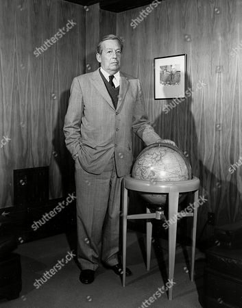 Douglas Donald Douglas Sr., founder of the Douglas Aircraft Corp., is shown standing by a globe in Santa Monica Calif