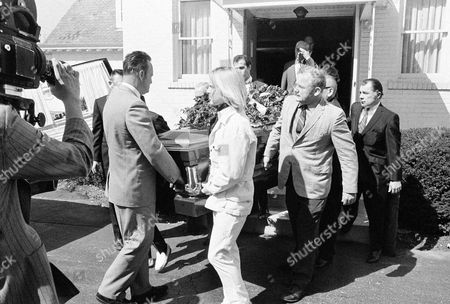 Stock Image of The body of Dr. Sam Sheppard, who died on Monday, is carried from a Columbus funeral home on following services and is taken to a suburban cemetery. Among the pallbearers is Bill Strickland, second from left, George Strickland, Sheppard's father-in-law and wrestling partner, second from right, and attorney F. Lee Bailey, right, who won acquittal in a second trial after conviction of Sheppard in the slaying of his first wife in 1954