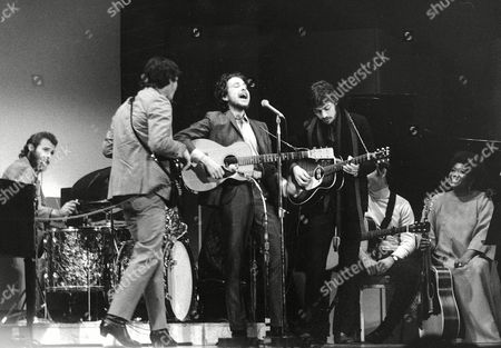 Bob Dylan, center, performs with drummer Levon Helm, left, Rick Danko, second left, and Robbie Robertson of The Band at Carnegie Hall in New York, in Dylan's first public appearance after his 1966 motorcycle accident. Dylan's tumble from his Triumph 50 years ago, was the most analyzed motorcycle crash in pop-culture history, but for all its importance, details surrounding the crash remain foggy