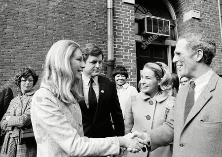 Sen. Edward Kennedy, center, and his wife, Joan, left, greet Boston Mayor Kevin White and his wife, Kathryn White, at their Charles street polling place, Boston Mass. The two couples arrived to cast their ballot. White, candidate for governor of Massachusetts against Republican Incumbent Francis Sargent, recently returned to the campaign after undergoing emergency surgery. During his hospitalization, Mrs. White conducted the campaign with assist from Sen. Kennedy