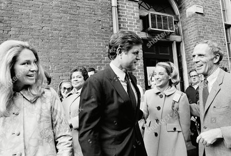 Sen. Edward Kennedy, center, and his wife, Joan, left, greet Boston Sen. Edward Kennedy, center, and his wife, Joan, left, greet Boston Mayor Kevin White and his wife, Kathryn White, at their Charles street polling place, Boston Mass. The two couples arrived to cast their ballot. White, candidate for governor of Mass. against Republican Incumbent Francis Sargent, recently returned to the campaign after undergoing emergency surgery. During his hospitalization, Mrs. White conducted the campaign with assist from Sen. Kennedy