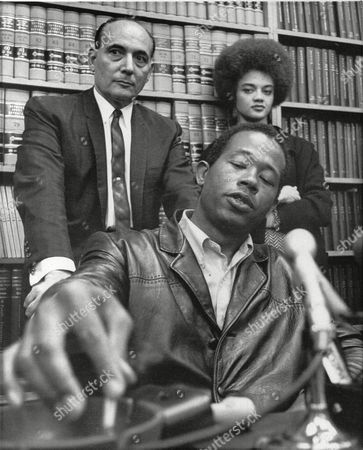 Eldridge Cleaver, Kathleen Cleaver, Charles Garry Eldridge Cleaver, minister of information for the Black Panther party, flicks ashes from his cigarette during press conference in attorney Charles Garry's San Francisco office, after being released on a $50,000 bail form Solano County Jail in San Francisco, . Behind Cleaver are his attorney, Garry, and his wife Kathleen. Cleaver was released on orders of a judge who ruled Cleaver had been held in California State Medical facility at Vacaville as a political prisoner for nine weeks