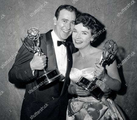 """Reiner Bergen Writer Carl Reiner and actress Polly Bergen pose with their statuettes at the Emmy Awards presentations in New York City, . Reiner won for best continuing supporting performance by an actor in a dramatic or comedy series for """"Caesar's Hour."""" Bergen won best single performance by an actress in a lead or support role for """"Playhouse 90: Helen Morgan Story"""