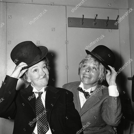 """Actresses Beryl Reid as Oliver Hardy, left, and Susannah York as Stan Laurel are seen ready for the shooting of a scene in the new film of """"The Killing of Sister George"""" in Chelsea, London on . Bery Reid plays an actress who, as Sister George in a TV series, is killed on the screen. Flashbacks of her life are shown. The film is from the stage play of the same name in which Beryl Reid starred both in London and New York"""