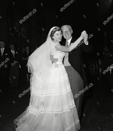 Mrs. Robert Sargent Shriver, the former Eunice Mary Kennedy, left, and her father, former Amb. Joseph P. Kennedy, are dancing at a reception following her marriage to Robert Sargent Shriver Jr. of Chicago, on in New York. The reception, at the Waldorf-Astoria Hotel, followed marriage ceremony at St. Patrick's Cathedral