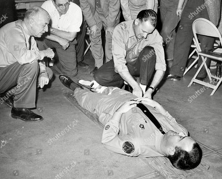 Members of Terrace Park's volunteer life squad are shown as they received instruction from James Noble on application of a traction fracture-splint in Cincinnati, . The Terrace Park group is one of many volunteer squads organized throughout the state to be on call at any hour for emergency first aid in cases of sudden illness or accident
