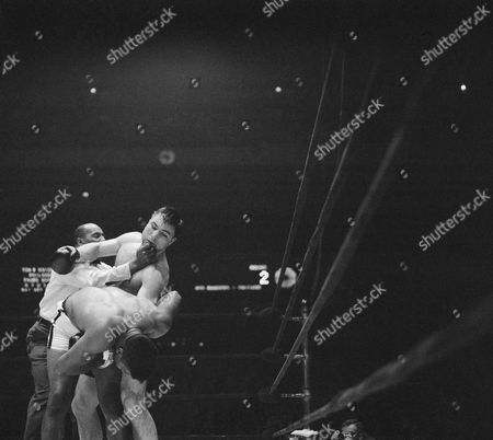 Stock Photo of Floyd Patterson, George Chuvalo, Zach Clayton Referee Zach Clayton seems to be tugging at George Chuvalo's chin in order to break-up clinch with Floyd Patterson in second round. Patterson won a unanimous 12-round decision at New York's Madison Square Garden