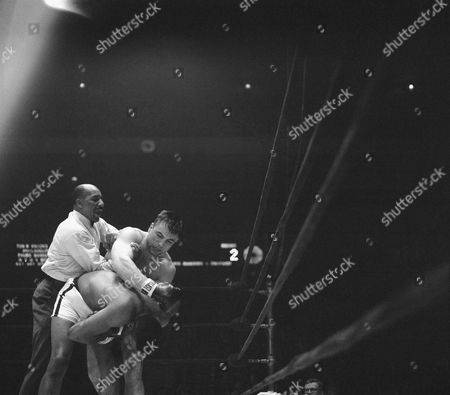 Editorial image of Floyd Patterson and George Chuvalo Referee Zach Clayton Action, New York, USA