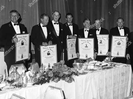 These are seven of the men admitted to football's Hall of Fame in New York, on . From left are: Robert J. Herwig, California center; W. Earl Sprackling, Brown quarterback; Allison Pooley Hubert, Alabama fullback; Kyle Rote, Southern Methodist back; Charles Oliver Carroll, Washington half back; Earl Red Blaik, coach at Dartmouth and Army; and Ray Richard Evans, Kansas back. Three others were admitted posthumously