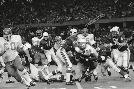 Kansas City Chiefs Richard Armstrong (35) is brought down by St. Louis Cardinals Don Parish (57) as he hits the Cardinals wall on kickoff of game at St. Louis, on . Armstrong managed to bring the ball from the end some to the 22 yard line. Action took place in the first quarter