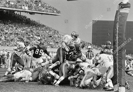 Kansas City Chiefs Willie Lanier (63) jumps to stop Minnesota Vikings ball carrier Oscar Reed (32) who leaps over lineman trying to score from goal line stand in first half of National Football Conference game Sunday in the Twin Cities at Minneapolis, on . Vikings accord on next play