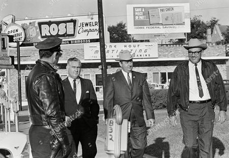 Rainey Price Neshoba County Sheriff Lawrence A. Rainey, right, and deputy Cecil Price, center, pass a Meridian policeman en route to court on the third day of their conspiracy trial in the slaying of three civil rights workers in Meridian, Miss., . At left is Richard Andrew Willis, another of 18 people charged under an 1870 federal law of conspiring to deprive Freedom Summer activists Andrew Goodman, Michael Schwerner and James Chaney of their civil rights