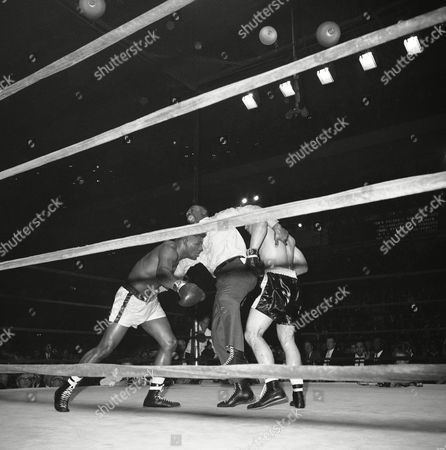 Stock Picture of Floyd Patterson, George Chuvalo Referee Zach Clayton struggles to separate the boxers as bout comes to its conclusion between George Chuvalo and Floyd Patterson. The former titleholder won a 12-round unanimous decision over the Canadian champ at Madison Square Garden in New York