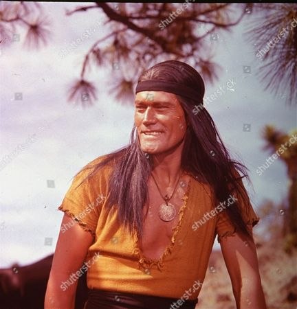 """Actor Chuck Connors, in costume for role as Geronimo in film """"Geronimo"""", July 1961"""