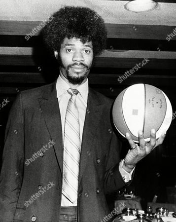 Artis Gilmore, 7-foot-2 player from Jacksonville University, is introduced to the press,, in New York, after he was signed by the Kentucky Colonels as their first round pick of the draft