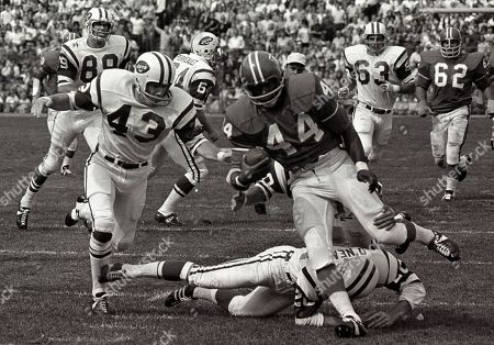 Floyd Little Denver Broncos' Floyd Little avoids the tackle of New York Jets' Steve O'Neal (20) during a football game in Denver. At left is Jets' John Dockery (43). In August 2009, a month after retiring from the car business by shuttering the dealership he'd run for 32 years, Little was finally a Pro Football Hall of Fame nominee, something he had started to suspect he'd never see in his lifetime