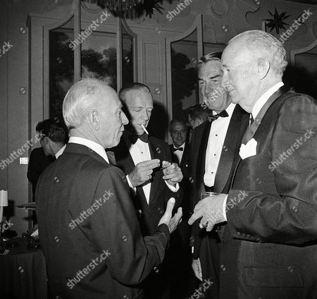 Harpo Marx, Fred Astaire, Randolph Scott, Walter Brennan A mixed quartet of old-timers at the party in Beverly Hills, California on . Left to Right: Harpo Marx minus his red wig, Fred Astaire, Randolph Scott and Walter Brennan