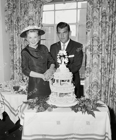 Singer Helen O'Connell, and novelist Tom T. Chamales are shown cutting their wedding cake at the St. Moritz Hotel in New York