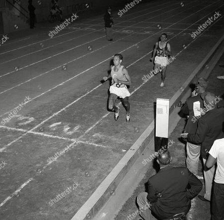 Herb Elliott of Australia beats his countryman, Merv Lincoln, to the wire by three strides to win the mile run in the National AAU track and field in 3:57:9, . The time excelled the recognized world record of 3:58 held by John Landy, although two other better times are pending. They may not be accepted because of the use of pacers in both races