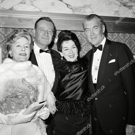 """Dunne Wayne Russell Stewart Actor Jimmy Stewart, right, is seen with fellow actors, left to right, Irene Dunne, John Wayne and Rosalind Russell at the premiere of """"How The West Was Won,"""", in Hollywood"""