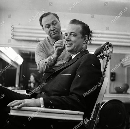 "Hugh Downs Television announcer and master of ceremonies Hugh Downs gets finishing touches of makeup in National Broadcasting Company Studio in RCA Building in New York's Rockefeller Center, . Makeup man is Irvin Carlton. Makeup was in preparation for Downs' morning question and answer show, ""Concentration."" The evening of February 15, Downs was scheduled to take place of Jack Paar on latter's nightly taped show. Downs was Paar's announcer before Paar walked off show last week in controversy with NBC brass"