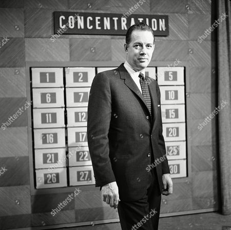 "Hugh Downs Television announcer and master of ceremonies Hugh Downs shown in National Broadcasting Company Studio in RCA Building, New York, in preparation for Downs' morning question and answer show, ""Concentration"