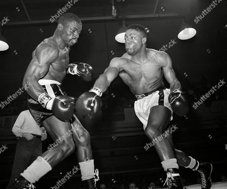 "Rubin Hurricane Carter, Rubin Carter, Walter Daniels Middleweight Rubin ""Hurricane"" Carter of Patterson, N.J., left, successfully avoids a right by Walter Daniels of Brooklyn, New York, in the first round of their bout at St. Nicholas Arena in New York, . Carter knocked Daniels down at 2:03 of the second round. Daniels rose at the count of eight, but the referee stopped the fight after looking Daniels over. It was Carter's fifth straight knockout"