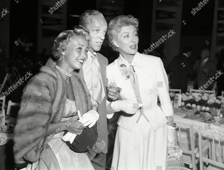 Stock Photo of Jane Powell, Fred Astaire, Greer Garson Three of Hollywood?s big names look over other arrivals, at the luncheon held on M.G.M. studio?s biggest sound stage. The affair terminated the studio?s sales convention. From Left to right are: Jane Powell, Fred Astaire and Greer Garson