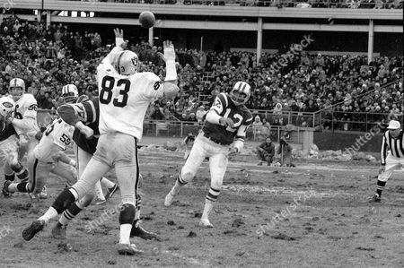 JOE NAMATH New York Jets quarterback Joe Namath gets a pass off in the first quater of the AFL championship game as Oakland Raider Ben Davidson (83) attempts to knock the pass down at Shea Stadium in New York City on . Namath threw three touchdown passes en route to a 27-23 win over the Raiders